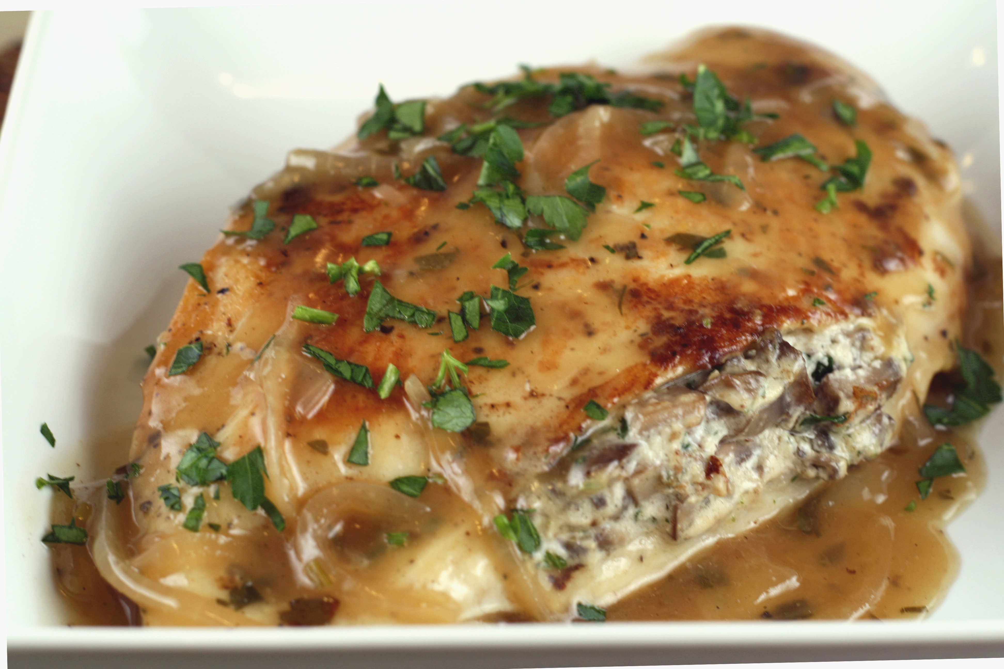 mushroom and goat cheese stuffed chicken with shallot pan sauce